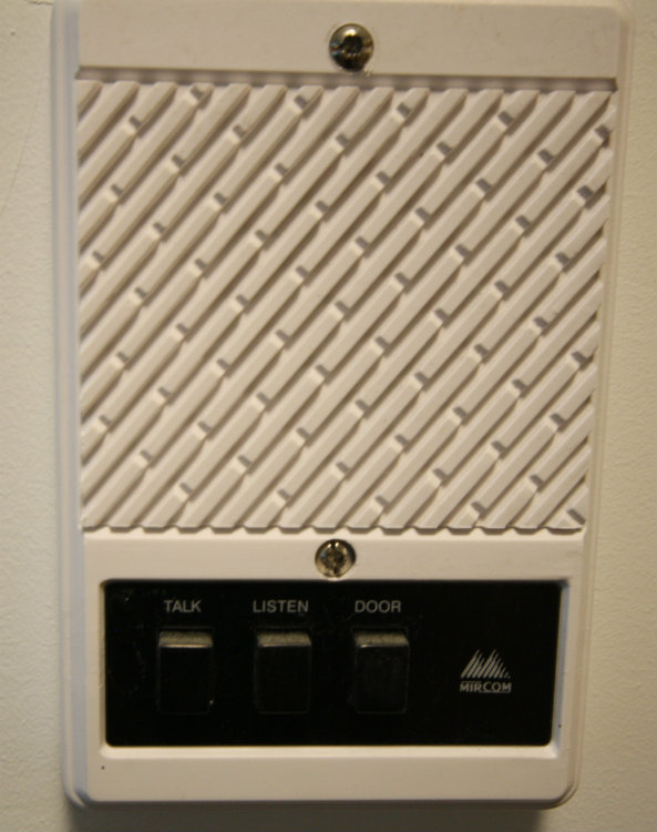 Electric locked front door switch with intercom in each suite