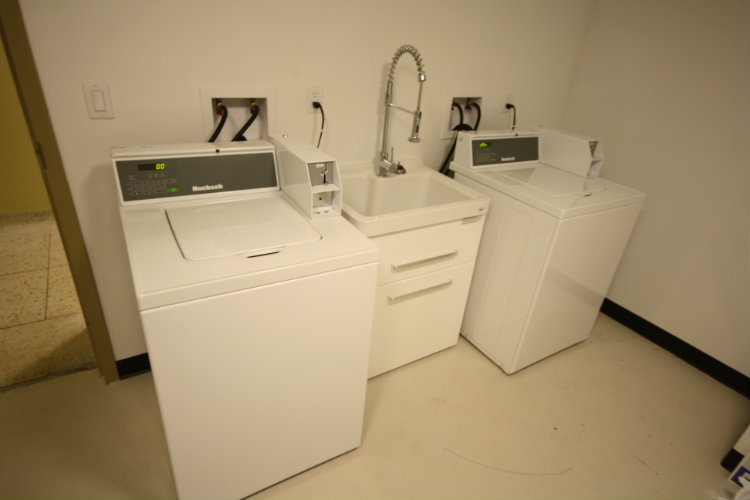 4 Laundry machines located in laundry room on lower floor