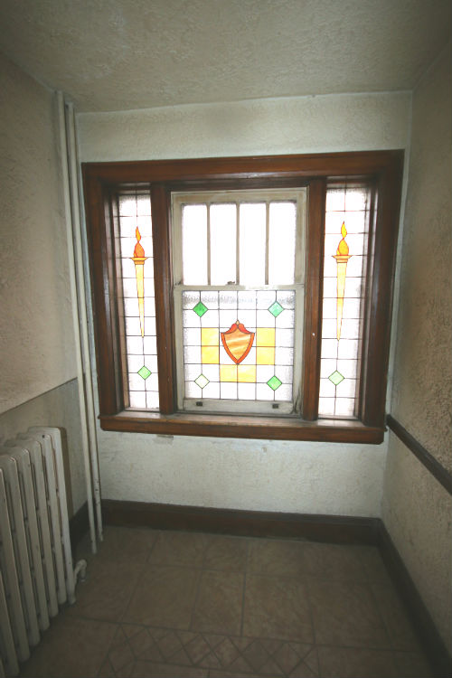 Stainglass at the front end of each hall