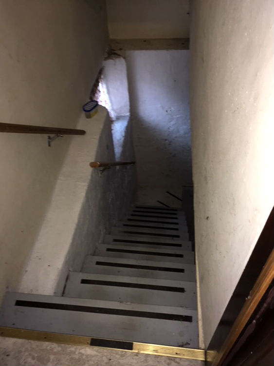 Basement stairs leading to laundry